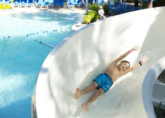 kid sliding down pool