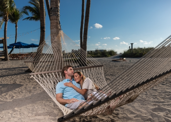 A couple relax in a hammock at South Seas Resort